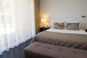 Uma cama ou camas num quarto em Solar Dos Cáceres