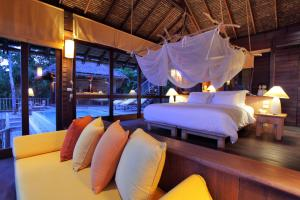 A bed or beds in a room at Six Senses Yao Noi