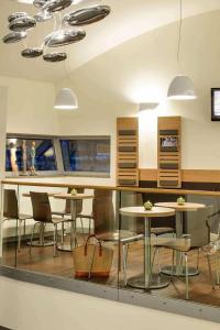 A restaurant or other place to eat at ibis Hotel Stuttgart City