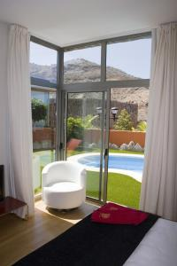 A view of the pool at Villas Opal Anfi Tauro or nearby