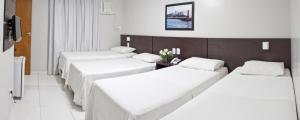 Cama ou camas em um quarto em Absolutte Hotel