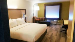A bed or beds in a room at Holiday Inn Express & Suites Pahrump, an IHG Hotel