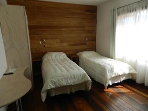 Кровать или кровати в номере Aroma Verde Hotel