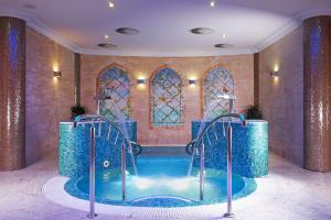 The swimming pool at or near Retro Riverside Wellness Resort
