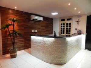 The lobby or reception area at Pousada Perola Dourada