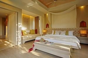 A bed or beds in a room at Melati Beach Resort & Spa - SHA Plus Certified