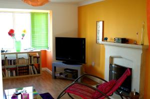 A television and/or entertainment center at Au Coin Des Couleurs