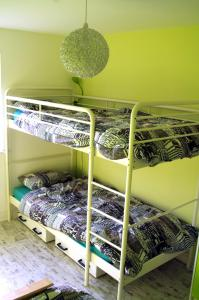 A bunk bed or bunk beds in a room at Au Coin Des Couleurs