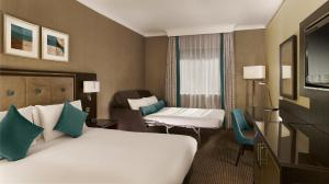 A bed or beds in a room at DoubleTree by Hilton Woking