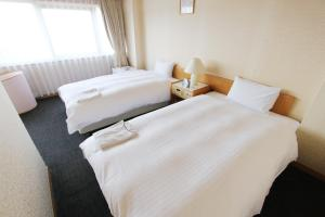 A bed or beds in a room at Smile Hotel Tokyo Tamanagayama
