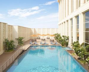 The swimming pool at or close to Taj Santacruz