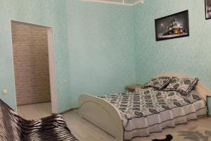 Кровать или кровати в номере Apartment Kamala
