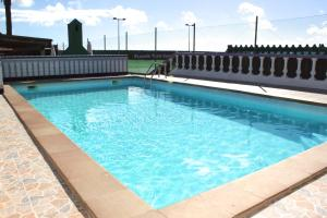 The swimming pool at or near Corralejo Lodge
