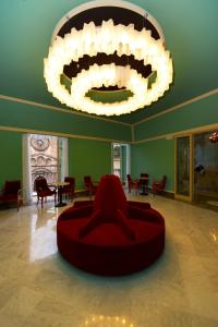 The lobby or reception area at Grand Hotel Piazza Borsa