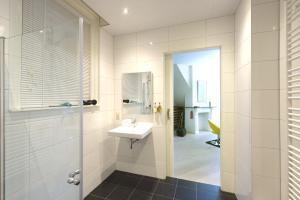 Een badkamer bij Suite aan de A