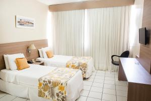 A bed or beds in a room at Rede Andrade Barra