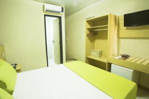 A kitchen or kitchenette at Rede Andrade Plaza Salvador