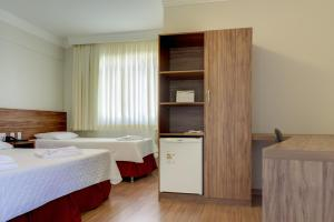 A bed or beds in a room at Hotel VillaReal