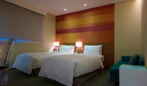 A bed or beds in a room at Beauty Hotels - Beautique Hotel