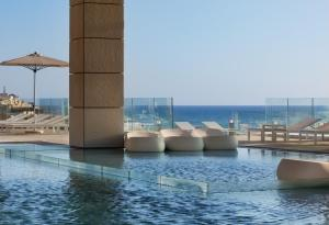 The swimming pool at or close to Royal Beach Hotel Tel Aviv by Isrotel Exclusive Collection