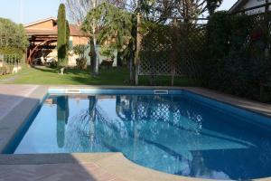 The swimming pool at or near La Villetta Suite