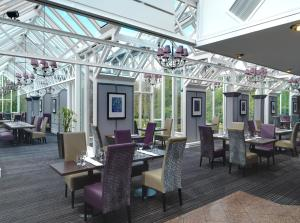 A restaurant or other place to eat at The Landmark Hotel and Leisure Club