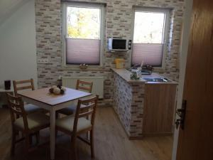 A kitchen or kitchenette at Rael-Boardinghouse
