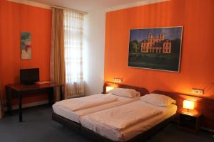 A bed or beds in a room at Hotel Merit