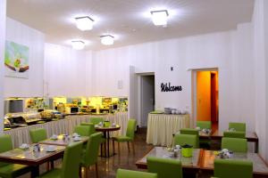A restaurant or other place to eat at Hotel Merit