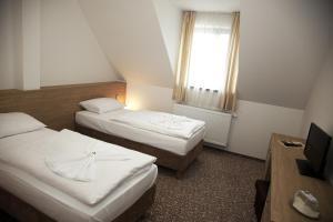 Кровать или кровати в номере Hotel Zámek Velká Bystřice