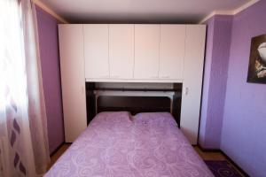 Postel nebo postele na pokoji v ubytování Ariete Apartments