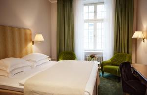 En eller flere senge i et værelse på Hotel Diplomat Stockholm