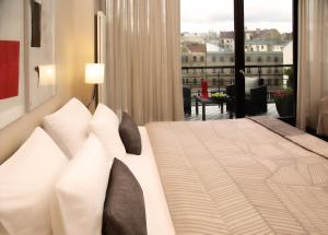 A bed or beds in a room at Hotel Bergs – Small Luxury Hotels of the World