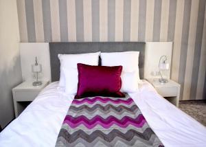 Łóżko lub łóżka w pokoju w obiekcie Apartament Lux