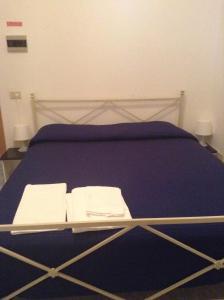 Кровать или кровати в номере Hotel La Rosa