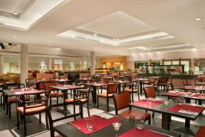 A restaurant or other place to eat at Hilton Garden Inn Rome Airport