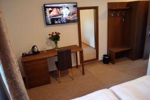 Телевизор и/или развлекательный центр в Hotel U Kvapilů
