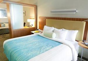 A bed or beds in a room at SpringHill Suites Wenatchee