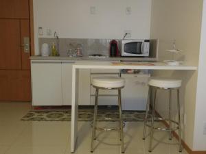 A kitchen or kitchenette at Flat em Brasília