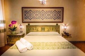 A bed or beds in a room at Fiore Di Maggio