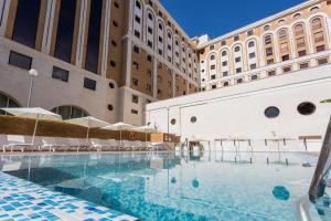 The swimming pool at or near Ayre Hotel Sevilla