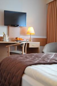 Кровать или кровати в номере Hotel Sachsentor
