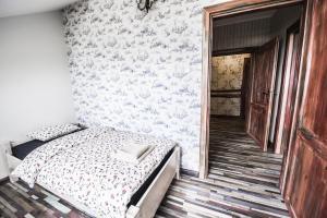 Łóżko lub łóżka w pokoju w obiekcie Folwark Księżnej Anny