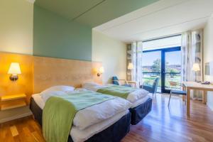 En eller flere senge i et værelse på Nyborg Strand - Hotel & Konferencecenter