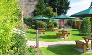 A garden outside Burton Hotel