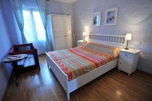 A bed or beds in a room at Il Casale Del Sapere e Del Sapore