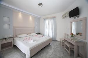 Ένα ή περισσότερα κρεβάτια σε δωμάτιο στο Ξενοδοχείο Ίλιον