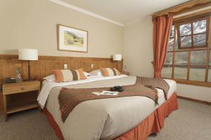 Cama o camas de una habitación en Hotel Las Torres Patagonia