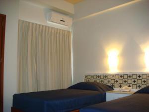 Cama o camas de una habitación en Hotel Roma