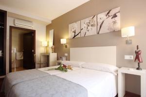 Letto o letti in una camera di Dormavalencia Hostel Regne